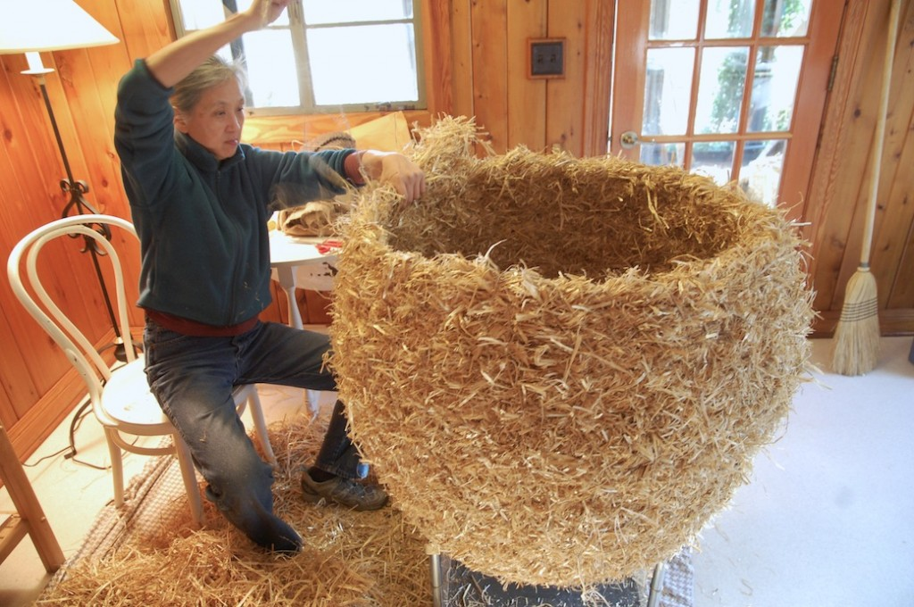 Working on a large straw sculpture at the Bernheim artist's house.